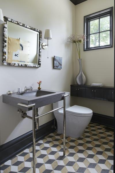 Powder room with geometric pattern on floor tile