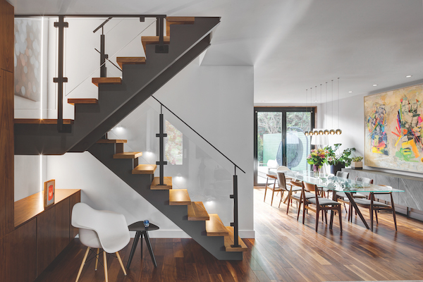 Scissor stairs leading to long dining table