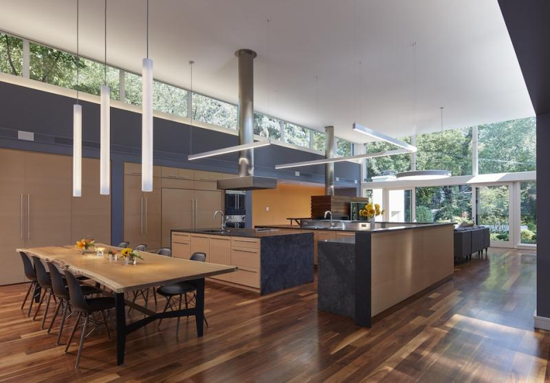 Open-floor-plan-with-kitchen-dining-area-and-clerestory-windows