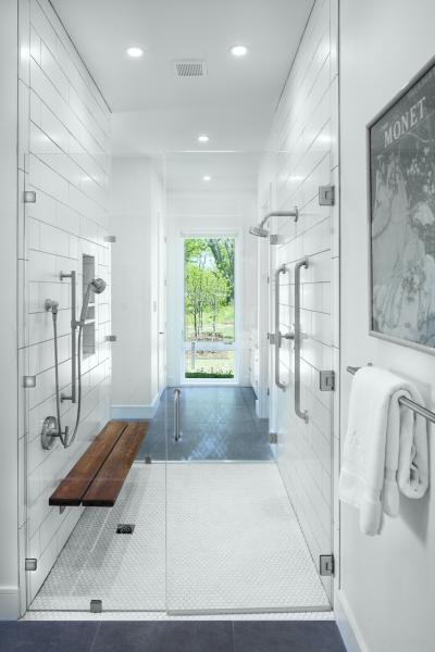 White tile shower stall with bench