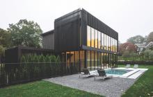 Modern style custom home using black stained cedar