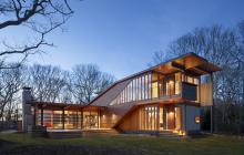 Custom home exterior with western red cedar and copper panel cladding