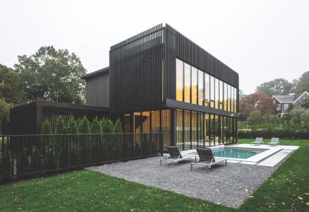 Modern style custom home using black stained cedar
