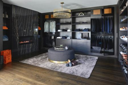 His master closet with fireplace designed by Yelena Gerts