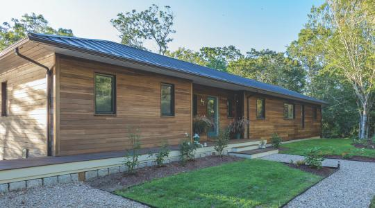 Poplar wood cladding on exterior of Cape Cod high-performance house